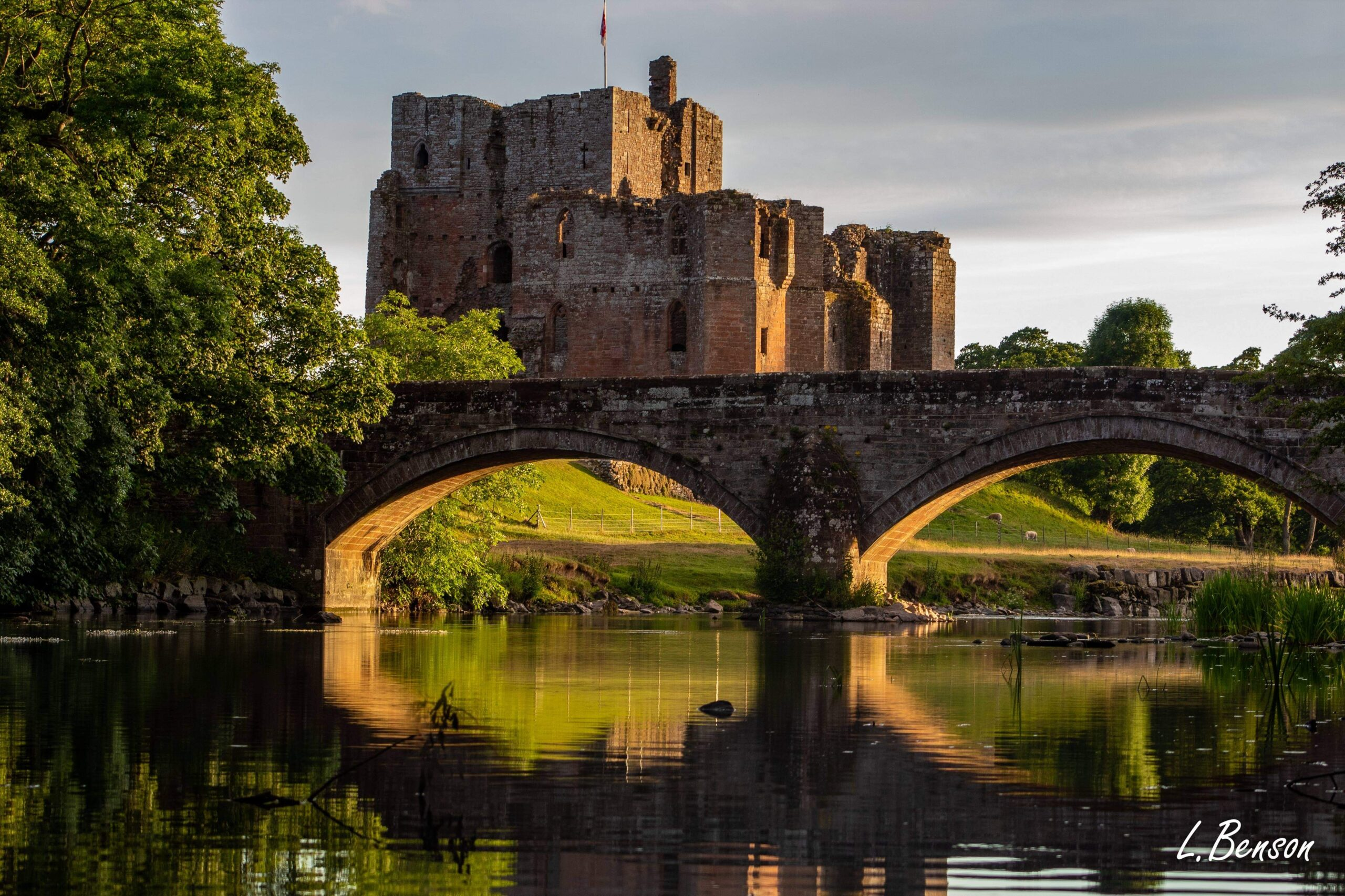 Brougham Castle viewed across the river and bridge