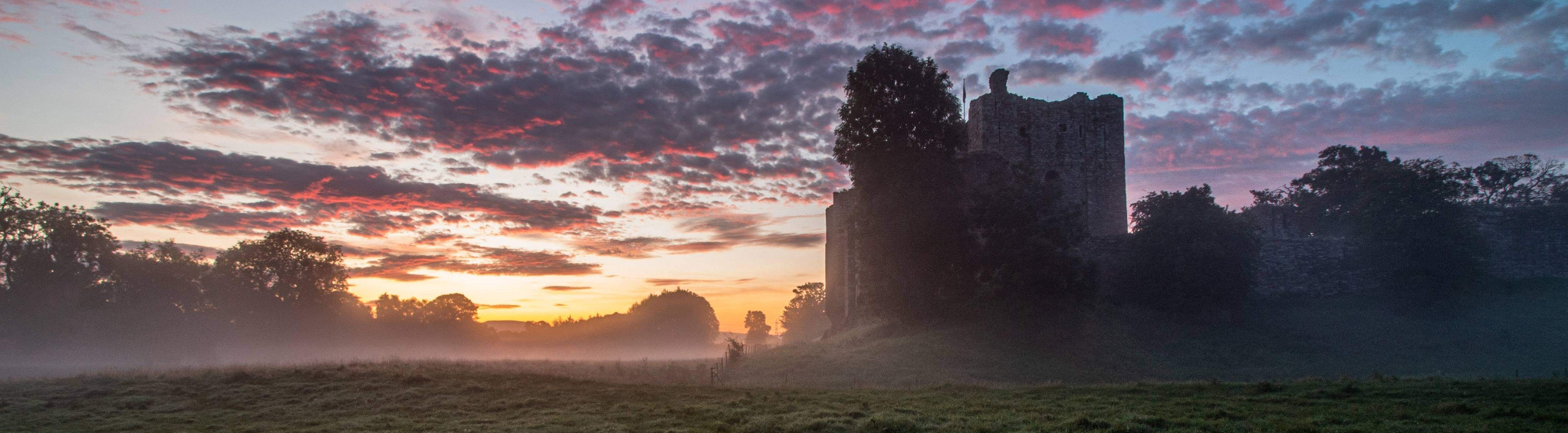 Brougham Castle through the mist by Lee Benson