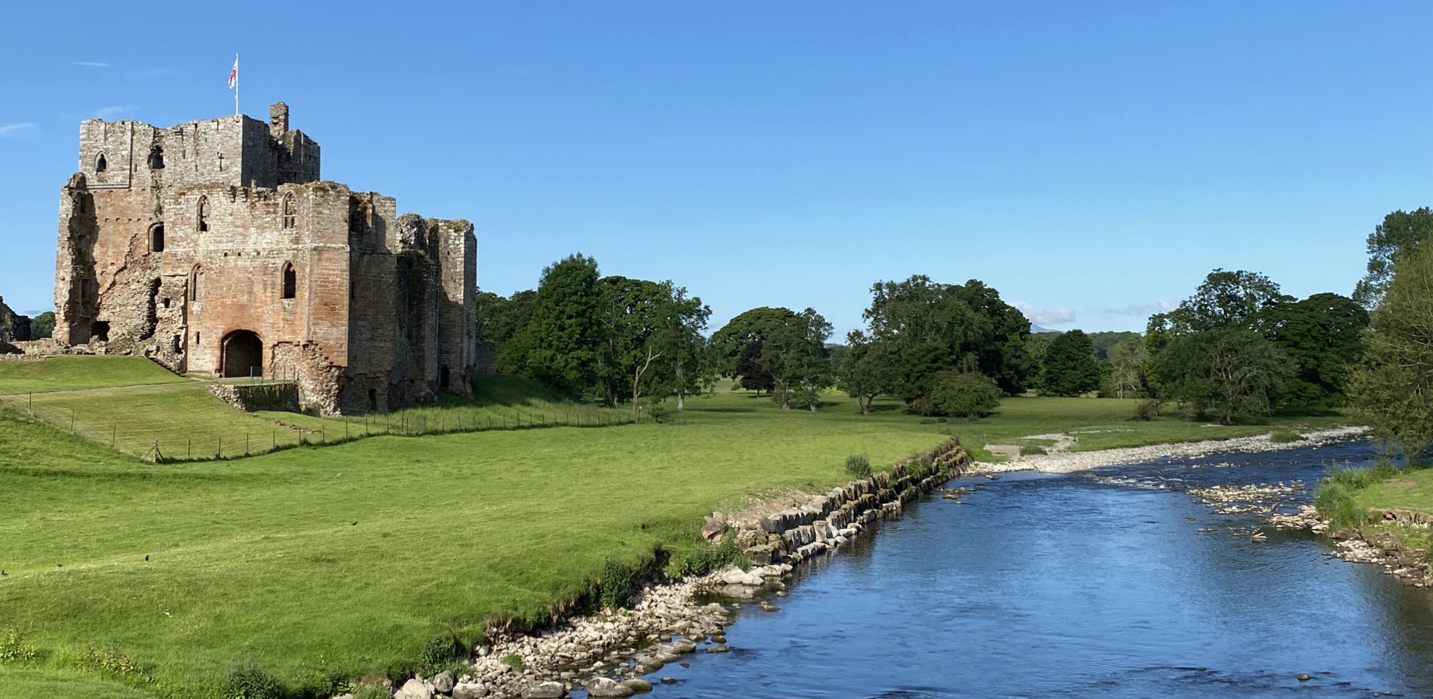 Brougham Castle and the river Eden in the sunshine